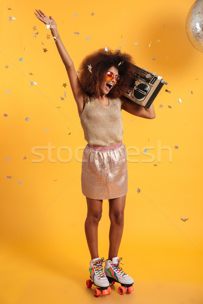 Full length portrait of beautiful overjoyed afro american disco  Stock photo © deandrobot