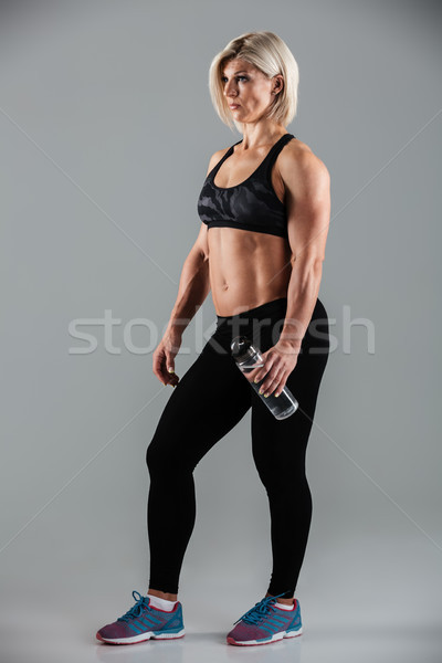Full length portrait of a muscular adult woman Stock photo © deandrobot