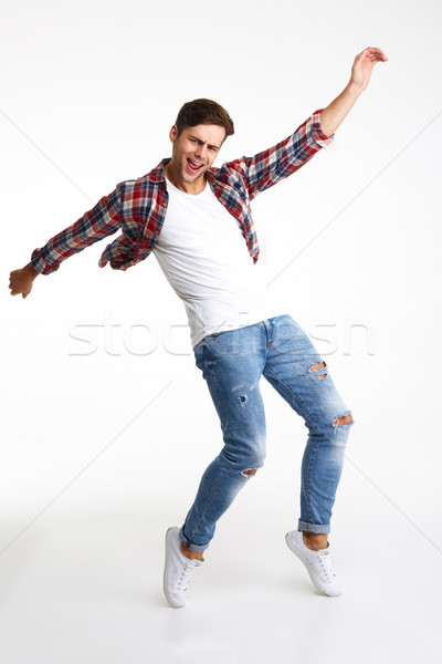 Full length portrait of an eaxcited happy man standing Stock photo © deandrobot