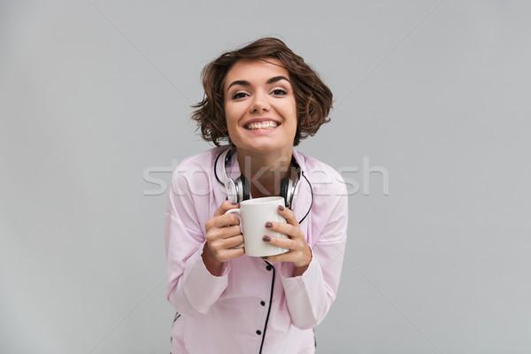 портрет счастливым возбужденный девушки пижама Сток-фото © deandrobot