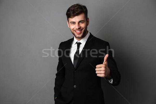 Fiatal sikeres üzletember hivatalos visel mutat Stock fotó © deandrobot