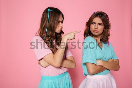 Twee verwonderd meisjes kleurrijk aanraken wangen Stockfoto © deandrobot