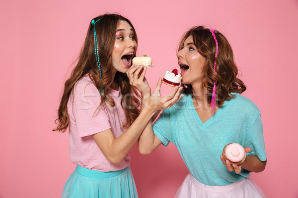 Stock photo: Portrait of two cheerful girls in colorful bright clothes