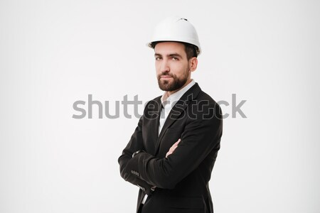 Cool bearded business man in protective helmet holding crossed arms Stock photo © deandrobot