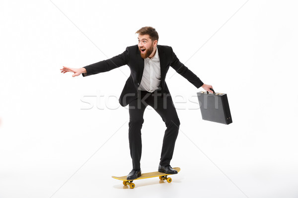 Teljes alakos kép játékos szakállas üzletember aktatáska Stock fotó © deandrobot