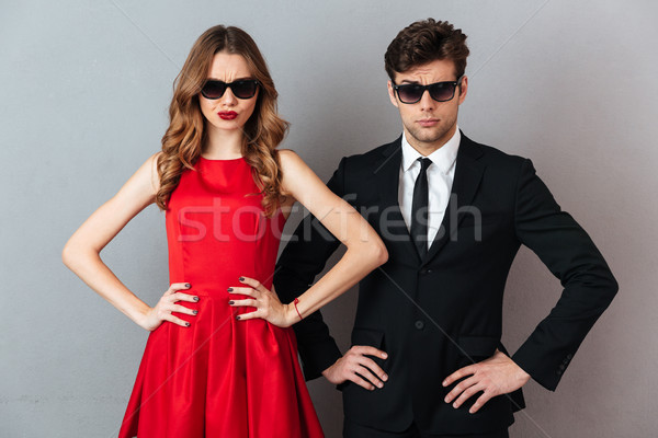 Portrait of a serious young couple dressed in formal wear Stock photo © deandrobot