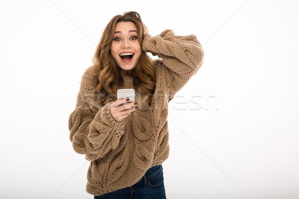 Sorprendido jóvenes cute dama teléfono Foto stock © deandrobot