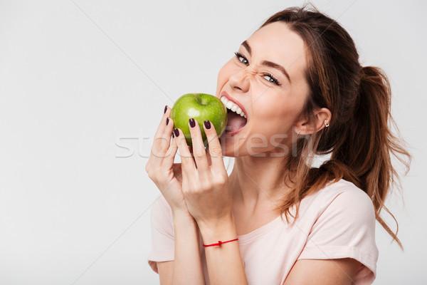 Faim drôle fille pomme Photo stock © deandrobot