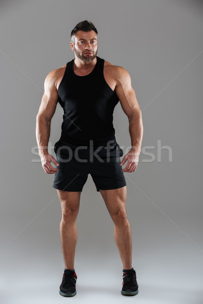 Full length portrait of a concentrated male Stock photo © deandrobot
