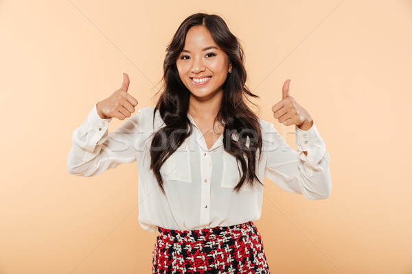 Portrait of asian candid female in casual looking at camera show Stock photo © deandrobot