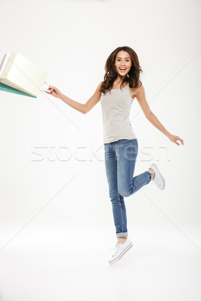 Full-length picture of delighted adult girl levitating or jumpin Stock photo © deandrobot