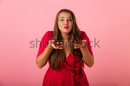 Portrait of a happy pretty girl holding fake lips Stock photo © deandrobot