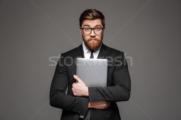 Retrato confundirse jóvenes empresario traje Foto stock © deandrobot