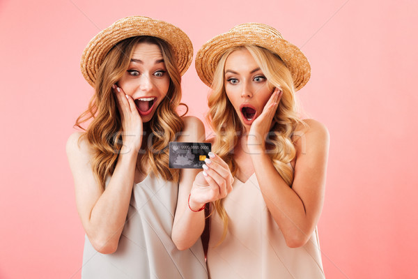 Portrait of two excited young women in summer clothes Stock photo © deandrobot