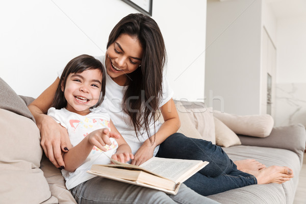 Portrait of joyful family mother and child spending time togethe Stock photo © deandrobot