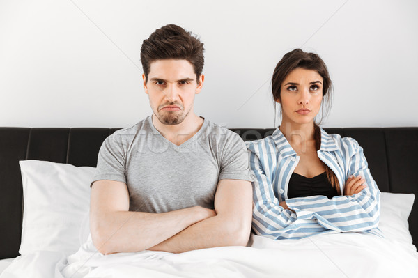Upset young couple having a conflict Stock photo © deandrobot