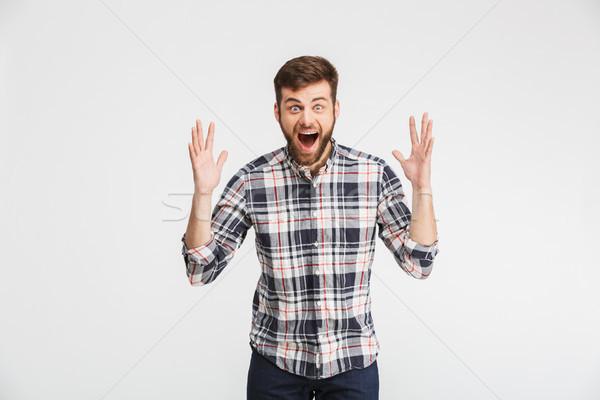 Photo stock: Portrait · excité · jeune · homme · célébrer · succès · isolé