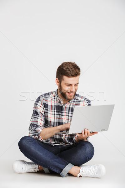 Portré mosolyog fiatalember kockás póló ül Stock fotó © deandrobot