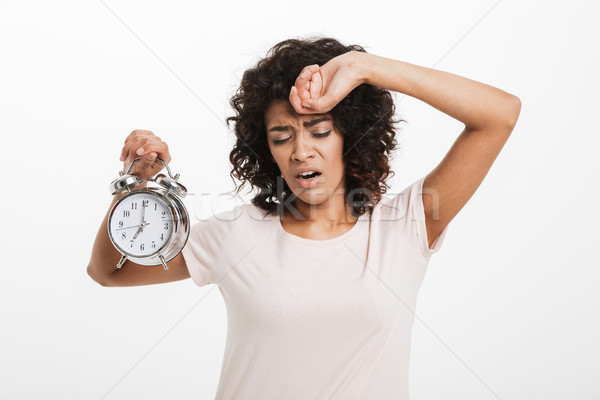 Portrait of a tired young afro american woman Stock photo © deandrobot