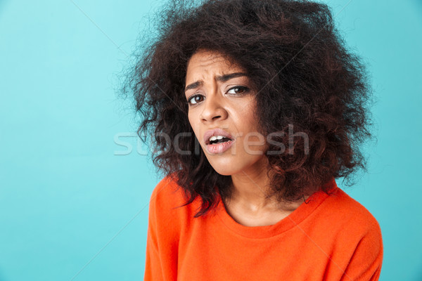 Colorful image closeup of puzzled woman in red shirt looking on  Stock photo © deandrobot