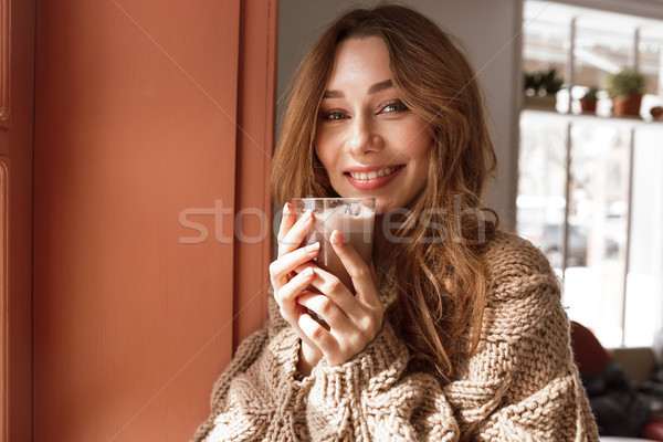 Photo closeup of gorgeous woman 20s posing on camera alone, and  Stock photo © deandrobot
