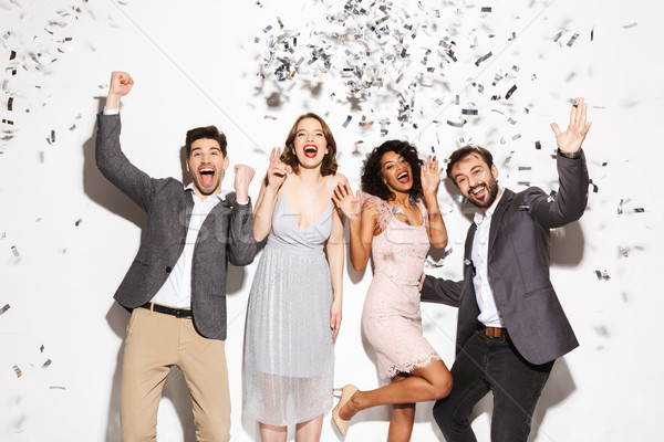 Group of happy well dressed multiracial people dancing Stock photo © deandrobot