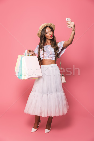 Full length photo of fashion woman wearing straw hat and fluffy  Stock photo © deandrobot