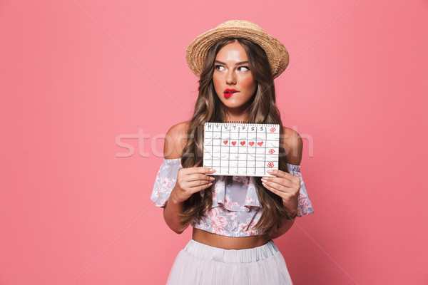 Portrait of brunette beautiful woman 20s wearing straw hat holdi Stock photo © deandrobot
