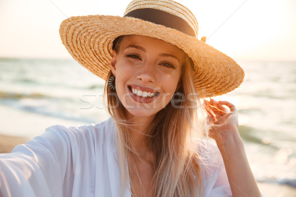 Delighted young girl in summer hat and swimwear Stock photo © deandrobot