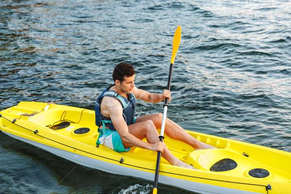 Moço caiaque lago feliz água homem Foto stock © deandrobot