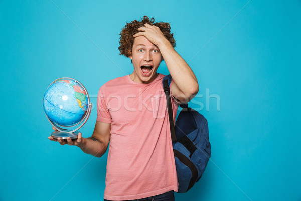 Portrait of young smarty guy with curly hair wearing backpack ho Stock photo © deandrobot