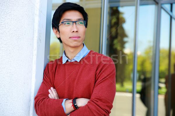 портрет задумчивый азиатских человека оружия сложенный Сток-фото © deandrobot