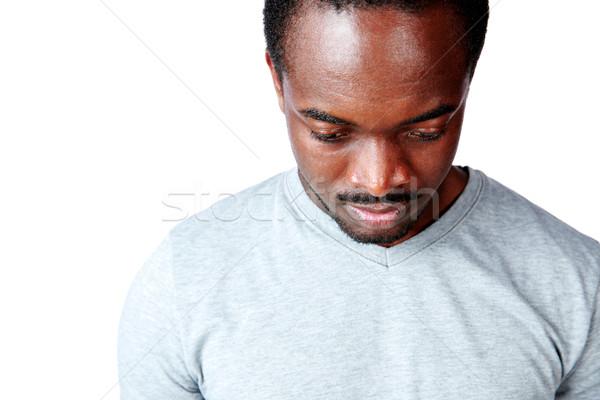 Retrato pensativo africano homem olhando para baixo preto Foto stock © deandrobot