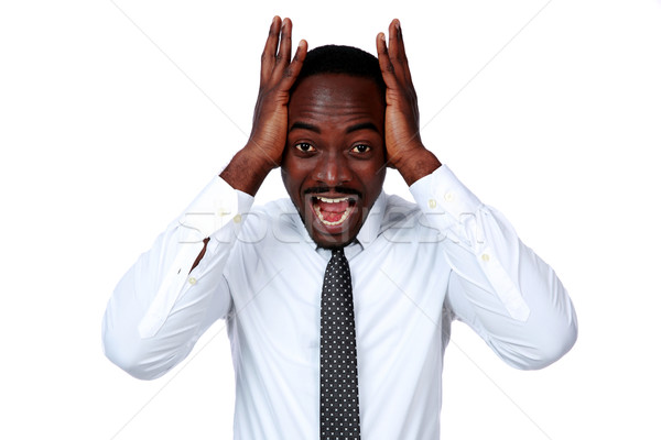 Portrait of a crazy african businessman shouting and closing ear by his hands on white background Stock photo © deandrobot