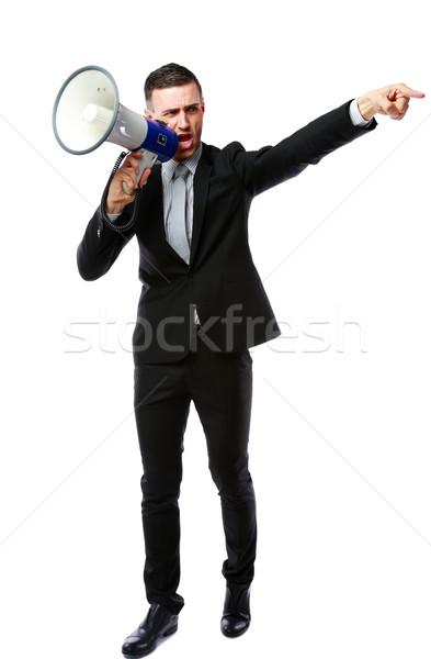 Full length portrait of businessman yelling through megaphone isolated on white background Stock photo © deandrobot