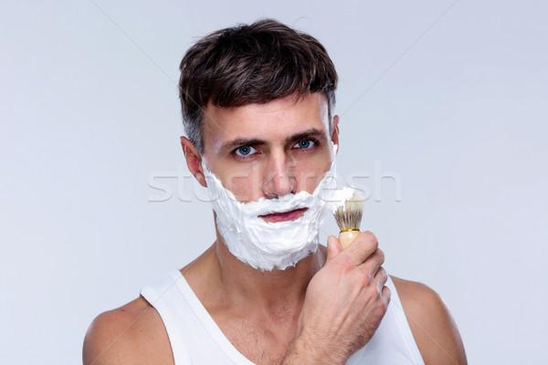 Adam tıraş köpük fırçalamak el Stok fotoğraf © deandrobot