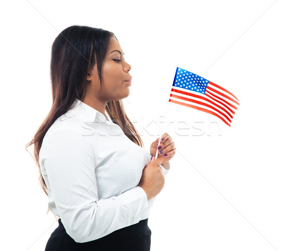 African businesswoman blowing on US flag Stock photo © deandrobot