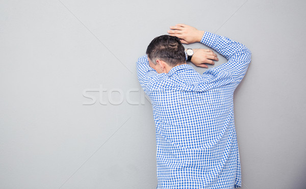 Man leaning on the wall Stock photo © deandrobot