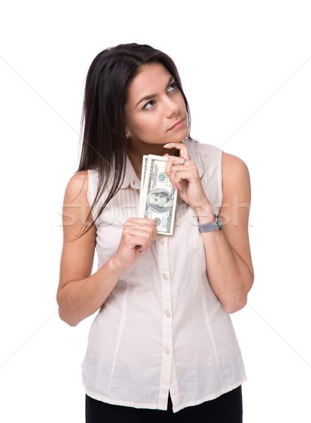 Peinzend vrouw dollar witte Stockfoto © deandrobot