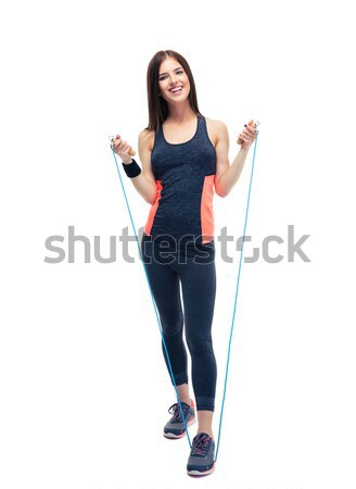 Sporty woman standing with jumping rope Stock photo © deandrobot
