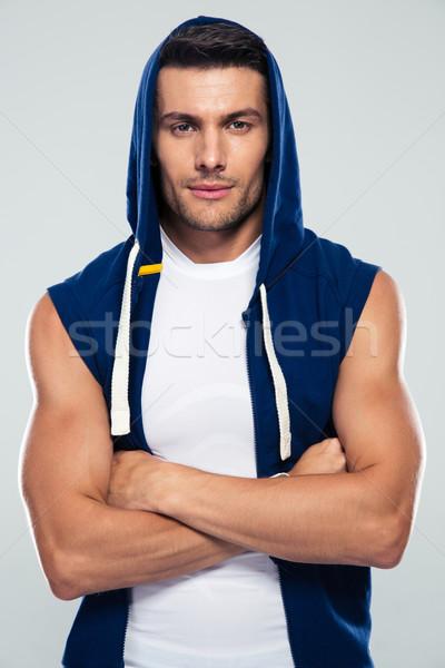 Foto stock: Fitness · hombre · pie · armas · doblado · gris