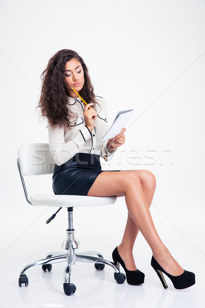 Femme d'affaires séance chaise de bureau portable crayon Photo stock © deandrobot