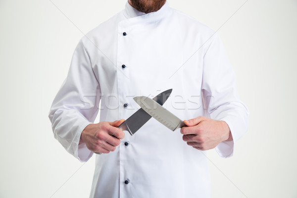 Closeup portrait of a male chef cook sharpening knife  Stock photo © deandrobot