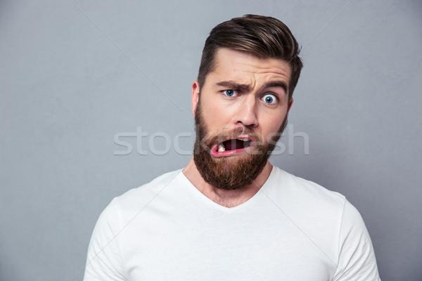 Férfi hülye bögre portré szürke haj Stock fotó © deandrobot