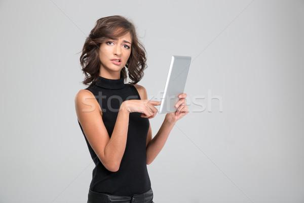 Deluso tablet infastidito nero vestiti Foto d'archivio © deandrobot