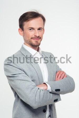 Glimlachend zakenman permanente armen gevouwen portret Stockfoto © deandrobot