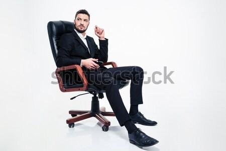 Foto stock: Pensativo · homem · de · negócios · sessão · cadeira · de · escritório · celular