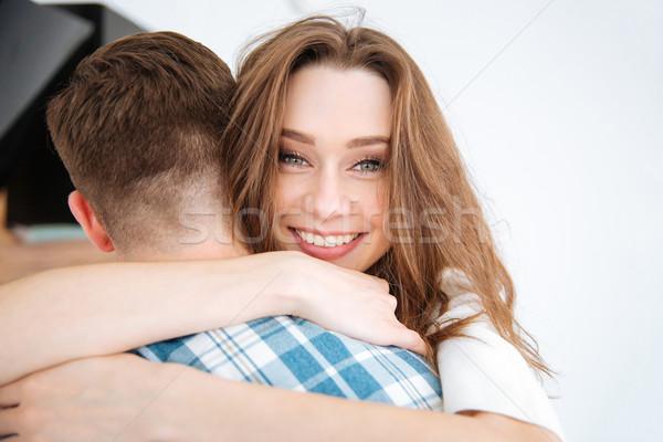 Happy woman hugging her boyfriend Stock photo © deandrobot