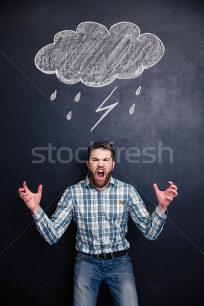 Mad człowiek krzyczeć tablicy za brodaty Zdjęcia stock © deandrobot