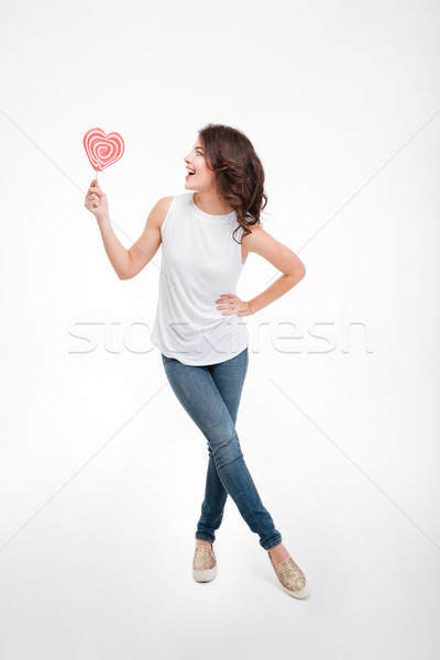 Cheerful woman holding lollipop  Stock photo © deandrobot